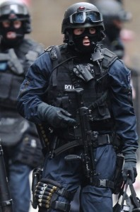 Armed police officers walk in Tottenham Court Road in central London